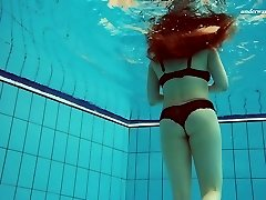 Beautiful Vesta stripping underwater in exciting solo movie