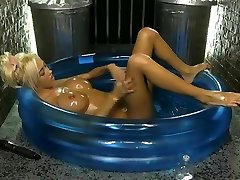 Kerrie Lee in a paddling pool frosted in oil