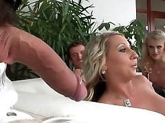Doting gals submit to a hardcore fuckin' on the bed in a reality shoot
