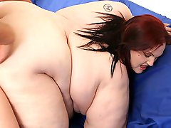 Slutty redhead spreading her flabby things for a hard pounding