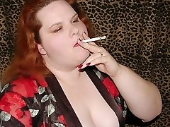 Warm busty BBW redhead smoking a ciggy