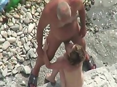 old & young heterosexual bottom naturist at the beach