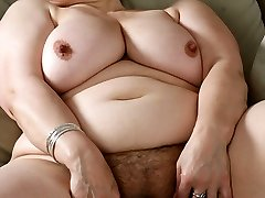 Plump mama rips her cute stockings off on cam