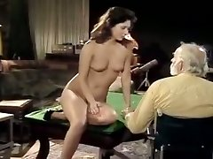 Bearded old guy gets his cock polished by pretty young dark-haired