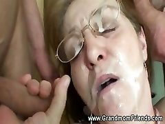 Horny granny gets facial from boys
