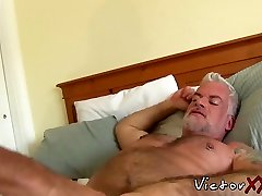 Tattooed old hunk having without a condom with boyfriend