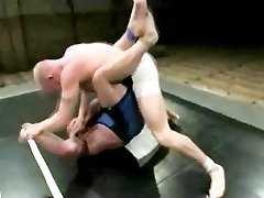 Two bodybuilders struggle nut to the wall and then fuck