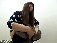 Asian breezies pee in toilet