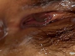 Young Asian babe receives a cream filled cunny