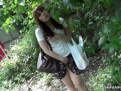 Beautiful and curious redhead Asian teen watches romp on the street and masturbates