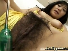 Lovely Asian model shows off her hot pussy