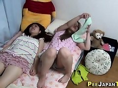 Asian whore rubs herself
