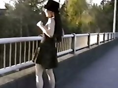 Asian girl flashes mammories from bridge