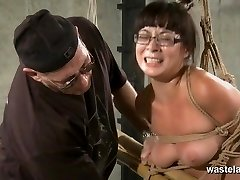 Bound and roped slave in glasses has orgasms
