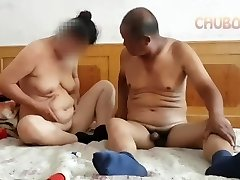 Chinese grandpa giving it to grandmother from behind