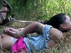 Asian teen tied and gagged made to orgasm!