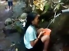 Indonesia lady outdoor nature shower