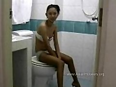 Thai Hooker Fellates Cock in the Toilet