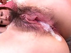 Pretty horn-raging Asian girlie with nice knockers takes double penetration