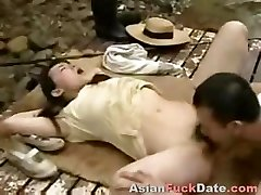 Horny Chinese husband and wifey duo get playful in the woods