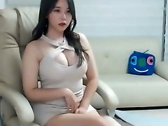 Sexy asian girl in pink mini sundress