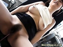 Asian stunner fucking a bottle up close