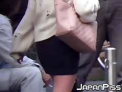 Hidden cam picks up Chinese chicks pissing at public toilet