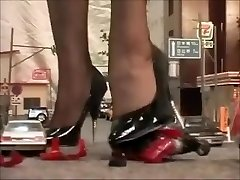 Japanese giantess dominatrix crushing city in high-heeled shoes and stockings