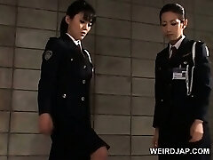 Dick starved asian police women giving hand job in jail