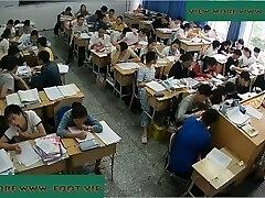 Teacher shoeplay in class Five