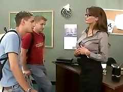 Huge-titted brunette teacher fucks and sucks her two students in threesome