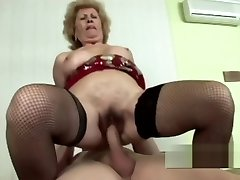 Hot as fuck GILF with tight vag riding hard boner