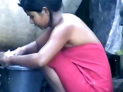 wow... outstanding desi village dame bathing outside