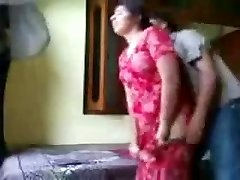 Indian duo enjoying in a hotel bedroom