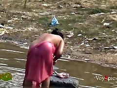 Desi mature aunty bathing in pond privately recorded