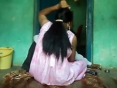 Barber shaving underarms hair of women .