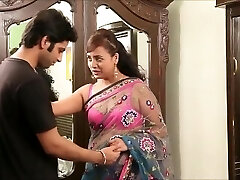 Indian teacher in stunning pink hooter-sling and sari seducing young guy