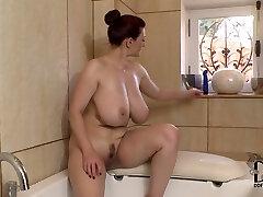 Well stacked brunette milf dildo fucks her bosom in the bath room