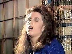 Girl in doorway rubs vag 80's