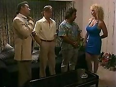 Busty blonde takes on two cocks and gets a dual invasion