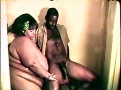 Big big gigantic black bitch loves a hard black cock between her lips and gams