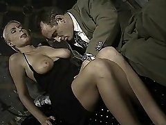Italian babe does bootie-to-jaws in this vintage clip