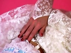 An Softcore Tease 001-A Brunette Hair Bride Undresses Out of Her Suit