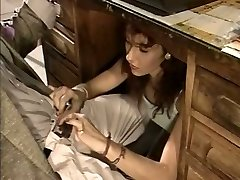 Trampy secretary gives her boss a oral pleasure under the table