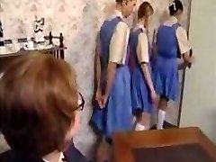 Crazy schoolgirls line up for their ass spanking punishment