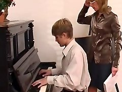 piano teacher dominates her schoolgirl