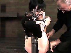 BDSM sub in chains gets feet punished