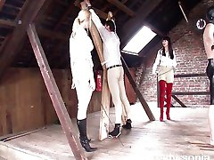 Riding-mistress-whips-stable-slaves