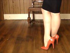 Shiney skirt, heels stockings and leg play!