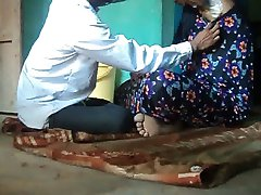 Barber shaving soft armpits hair of a girl using straight razor.